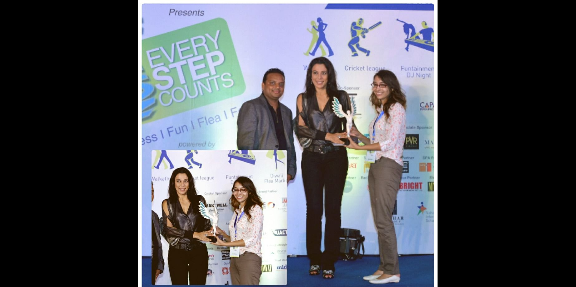Rupal Jain, the founder & owner of Kreativekeeda.com getting best stuff award at an event.